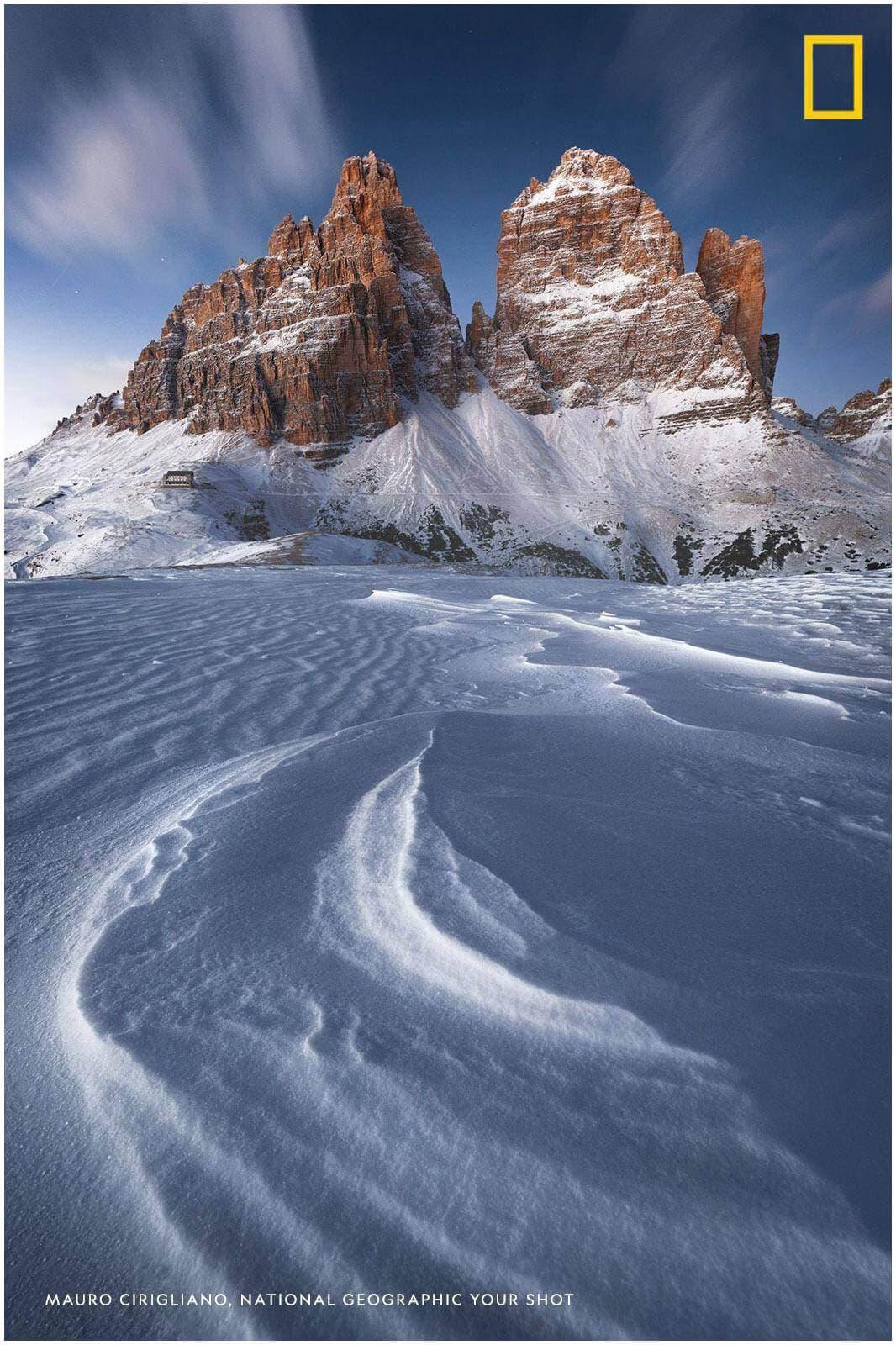 foto pubblicata su national geographic con montagne e neve in primo piano