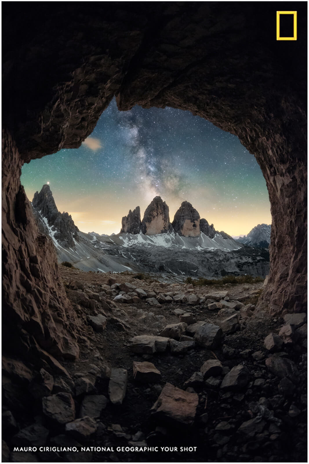 photo published on national geographic of the three peaks of lavaredo photographed from a cave