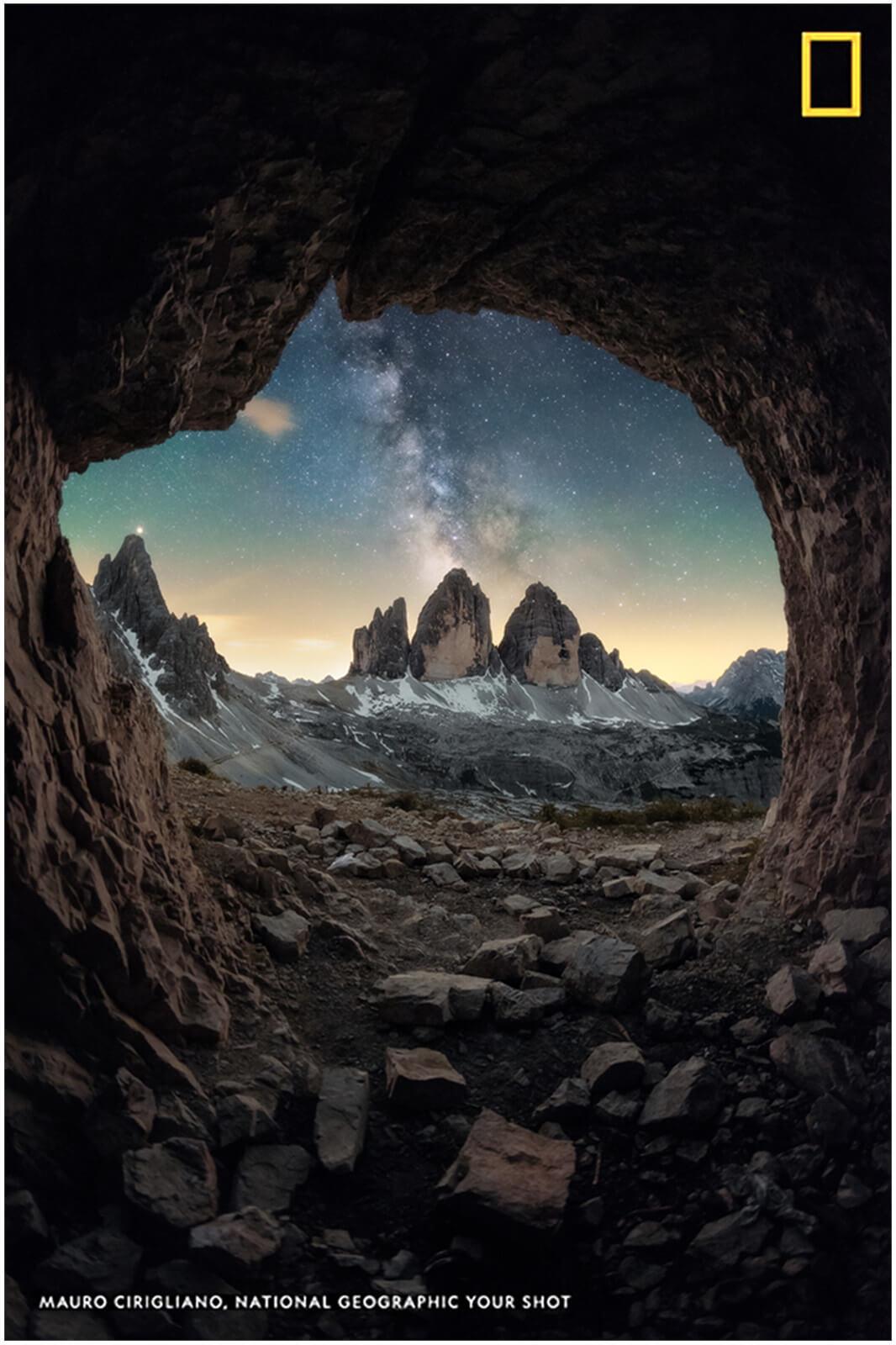 foto pubblicata su national geographic delle tre cime di lavaredo fotografate da una grotta