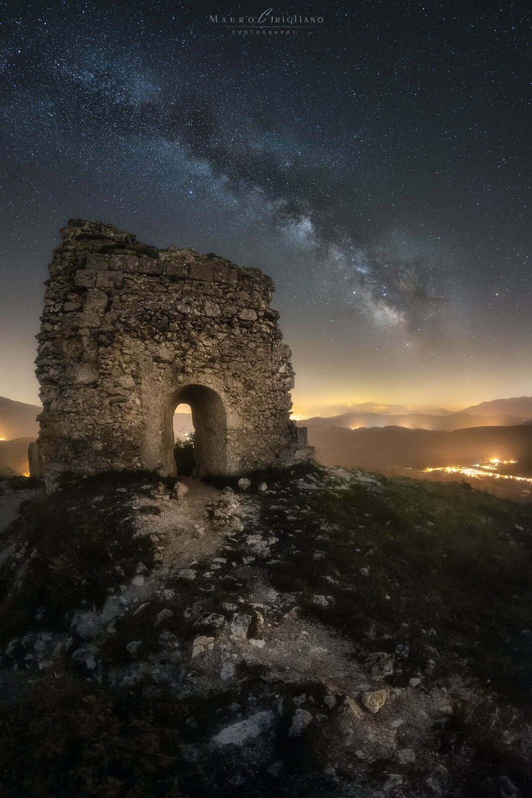 starry sky over ancient stone ruins